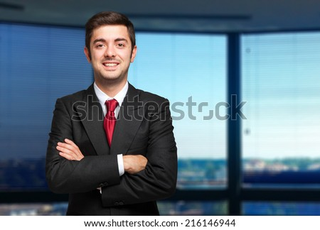 Portrait of a young businessman in a modern office - stock photo