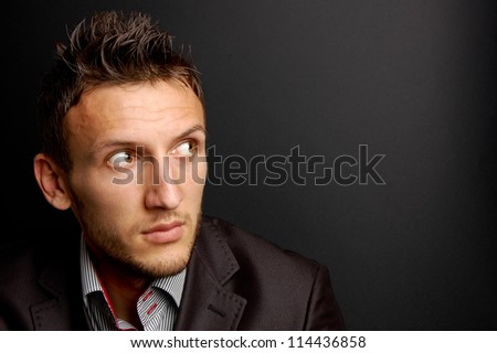 portrait of a young businessman on gray background