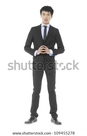 Portrait of a young businessman standing - Full body