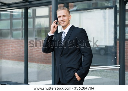Portrait Of A Young Businessman Talking On Cellphone