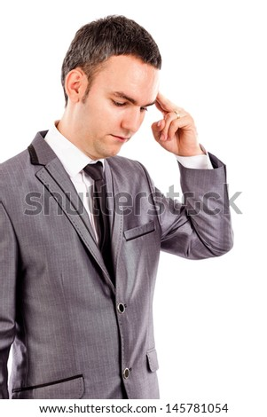 Portrait of a young businessman thinking hard isolated on white background - stock photo