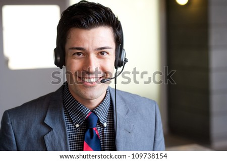 portrait of a young businessman wearing headset - stock photo