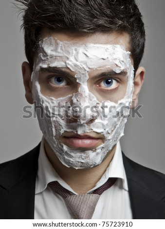 Portrait of a young businessman with a face full of shaved foam