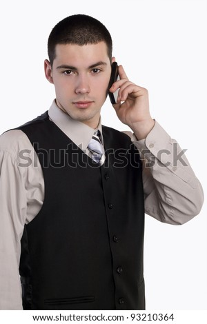 Portrait of a young businessman with mobile phone - stock photo