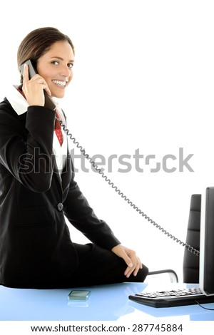 Portrait of a young businesswoman on the phone at workplace - stock photo