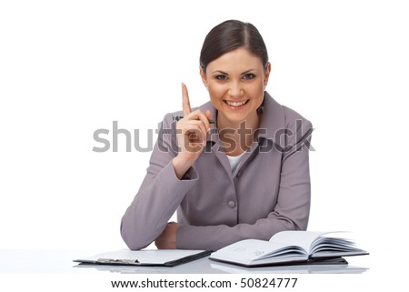 Portrait of a young businesswoman pointing her finger with clipboard, pe and diary over white - stock photo
