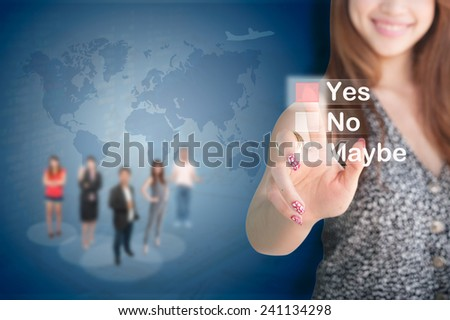 portrait of a young businesswoman voting for yes has team and map background  - stock photo