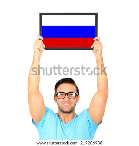 Portrait of a young casual man holding up board with National flag of Russia - stock photo