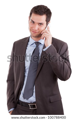 Portrait of a young caucasian business man using a mobile phone,isolated on white background - stock photo