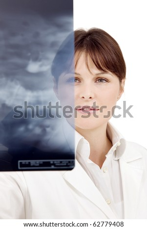 portrait of a young caucasian female doctor examining an X-ray - stock photo