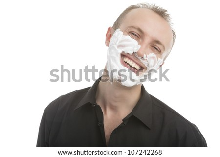portrait of a young caucasian handsome man with shaving foam preparing to shave isolated over white