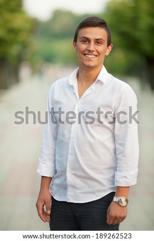 Portrait of a young Caucasian man outdoors