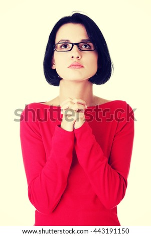 Portrait of a young caucasian woman praying - stock photo