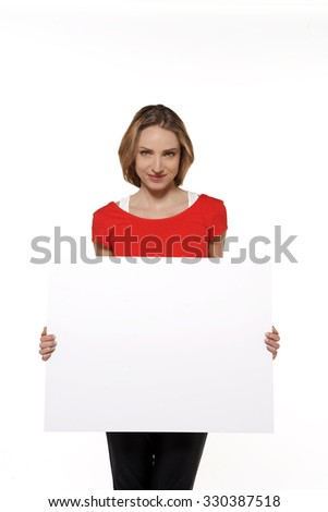 portrait of a young Caucasian woman with whiteboard - stock photo
