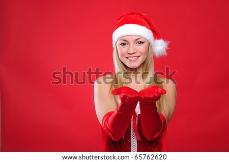 Portrait of a young charming girl dressed as Santa. Happy New Year! - stock photo