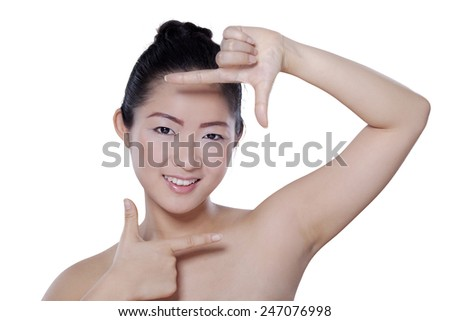 Portrait of a young chinese girl with healthy skin after treatment, shot in the studio isolated on white