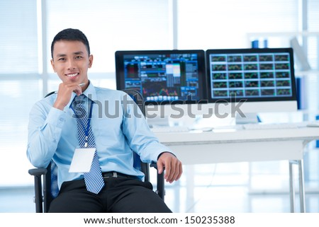 Portrait of a young confident broker - stock photo