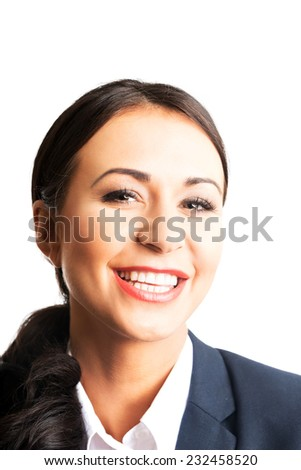 Portrait of a young confident business woman smiling to the camera.