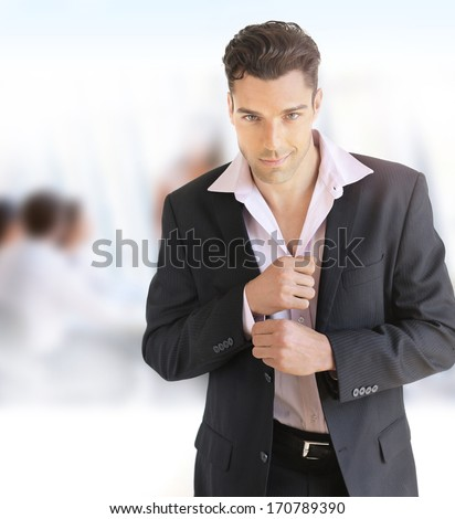 Portrait of a young confident businessman in office setting - stock photo