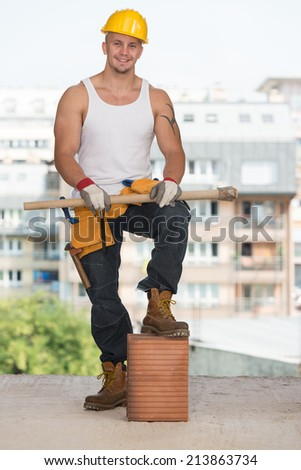Portrait Of A Young Confident Worker - Construction Worker Relaxing The Fresh Air During Work - stock photo