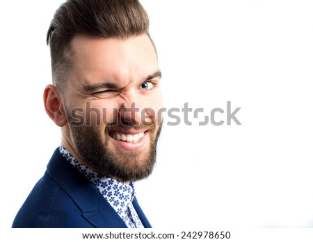 Portrait of a young cool man winking - stock photo
