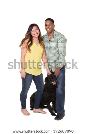 Portrait of a young couple and their dog - stock photo