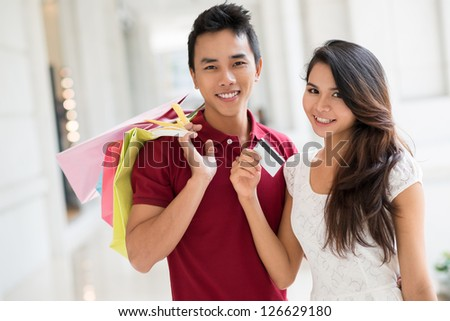 Portrait of a young couple doing shopping - stock photo