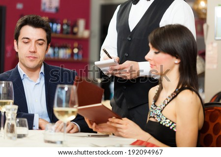 Portrait of a young couple eating at a restaurant