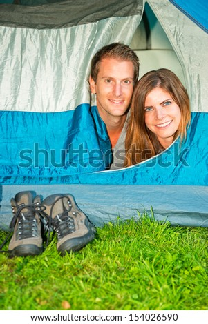 Portrait of a young couple in a tent