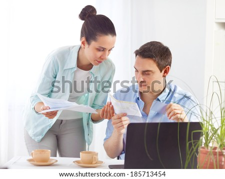 Portrait of a young couple paying bills online