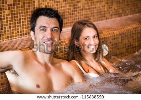 Portrait of a young couple relaxing in a spa - stock photo