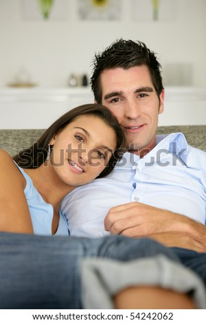 Portrait of a young couple sitting on a sofa