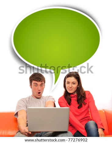 Portrait of a young couple using a computer. Isolated white background.