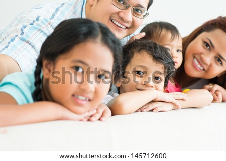 Portrait of a young cute boy posing with his family on the foreground