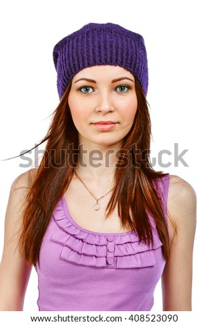 Portrait of a young cute girl in a purple hat and a pink shirt.Isolated on white background. - stock photo