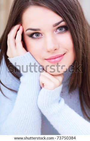 Portrait of a young cute woman in warm sweater