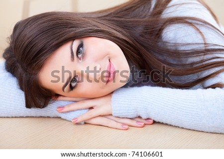 Portrait of a young cute woman in warm sweater - stock photo