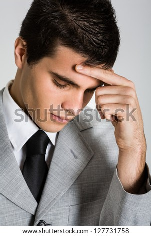 Portrait of a young depressed businessman - stock photo