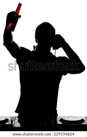 Portrait of a young DJ with mixer at the work, is drinking alcohol. - stock photo