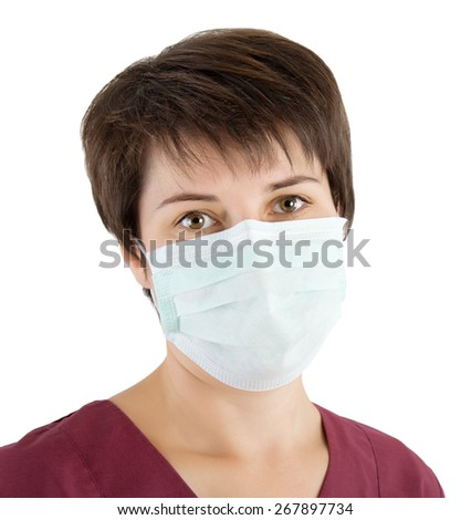 portrait of a young doctor wearing a mask - stock photo