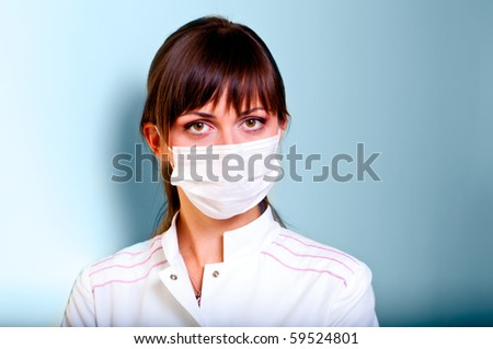 Portrait of a young doctor with bandage - stock photo