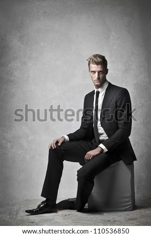 Portrait of a young elegant businessman - stock photo