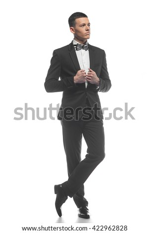 Portrait of a young elegant handsome business man isolated on white background