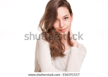 Portrait of a young, expressive, beautiful brunette woman.