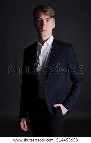 portrait of a young fashion man in suit