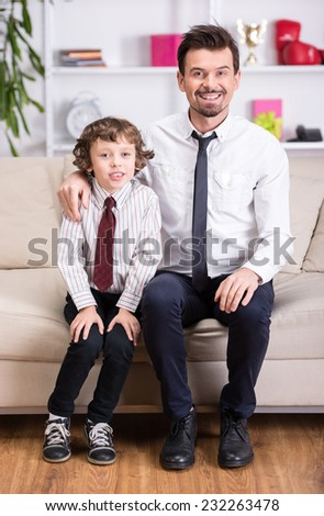 Portrait of a young father and his son in a shirt and tie. - stock photo