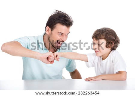 Portrait of a young father and son who spend time together. - stock photo