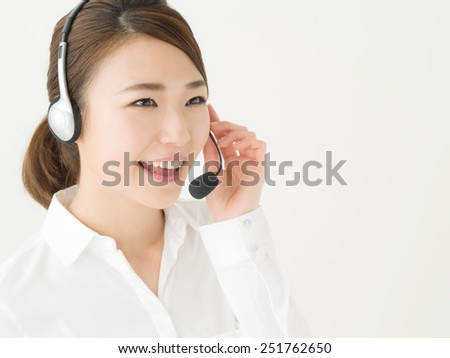 Portrait of a young female customer service operator - stock photo