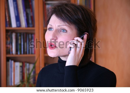 Portrait of a young female on the phone arguing