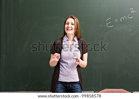 portrait of a young female teacher in the classroom